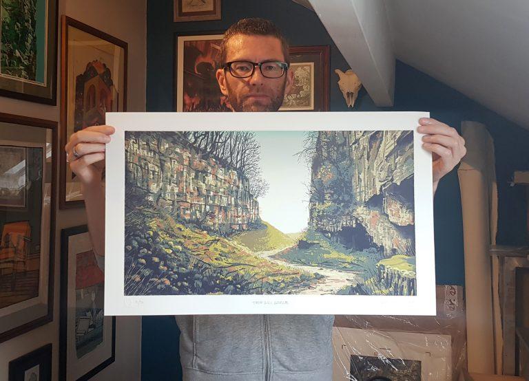 Artist Graham Pilling holds his new landscape Silkscreen Print of Trow Gill Gorge